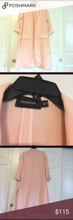 Mink pink coat Mini pink long coat! Great condition only worn once to a wedding. Super cute over a small dress as featured in the photo! Also with jeans and a scarf. Cleaning closet hate to see it go but need room! MINKPINK Jackets & Coats Trench Coats