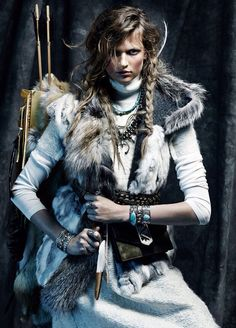 Fashion and style: bo-ho at its best! Whites + fur vest with hood + Jewellery! bracelets! cool makeup and hair! Bette Franke: VOGUE Spain. Photographer: Tob Knott