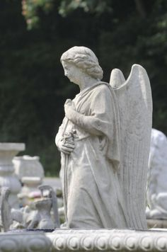 A concrete angel is among Roger Rhea's assemblage of concrete figurines and furniture at Rhea's Concrete Products near Clinton. Everything comes out of rubber-lined fiberglass molds, lubricated with castor oil and methyl to keep the concrete from sticking. (J. Miles Cary/News Sentinel)