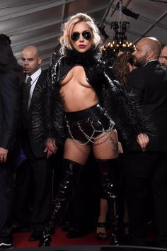 "Just a week after her aerial-trick and drone-filled Super Bowl half-time show, Lady Gaga hit the red carpet at the Grammy Awards and she didn't go ignored. The singer rocked a revealing spikey crop top, short shorts and latex boots on the red carpet before taking to the stage to perform ""Moth into Flame"" with Metallica."