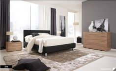 Minimalist bedroom--white, black, but cozy tans/textures