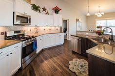 A great shot of our NEW model home's kitchen. Tell us what you think.