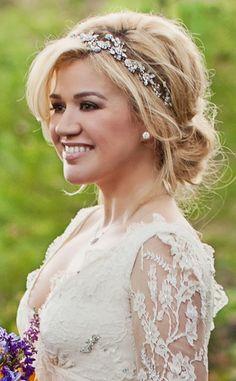 low undo wedding hair and a headpiece.