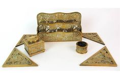 Lot 167 - A Tiffany Studios glass and gilt bronze Grapevine pattern four-piece desk set circa 1915, comprising