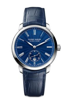 The Ulysse Nardin Classico Manufacture Grand Feu is powered by an in-house movement, self-winding Caliber UN-320; the watch features a date corrector that can be set both forward and backward.  Its blue grand feu enamel dial is handcrafted at Donzé Cadrans, which specializes in the art of enameled watch dials.  More @ http://www.watchtime.com/wristwatch-industry-news/watches/ulysse-nardin-classico-manufacture-grand-feu-and-hourstriker-pin-up/ #ulyssenardin #watchtime  #horology #SIHH2017
