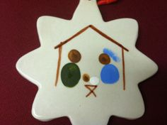 Fingerprint nativity ornament - great to make for a child's first Christmas.
