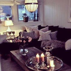 This cosy living room area includes cushions and candles - perfect for creating a romantic vibe