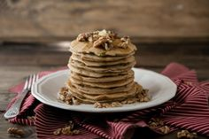Zucchini Bread Pancakes Recipe Breakfast and Brunch with whole wheat pastry flour, baking powder, salt, cinnamon, nutmeg, maple syrup, eggs, walnut oil, milk, shredded zucchini, toasted walnuts, butter, maple syrup