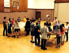 Bed sheet ping pong.  Super easy and such a fun cooperative game. The youth had to pass back and forth a ping pong ball. Then we switched it up and had them throw it in the air as far as they could. King sheets would be fun too. The YW and YM had a great time!