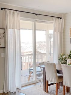 Click to see how to make simple and inexpensive DIY Tablecloth Curtains! Perfect for any room in your house! The length can easily be adjusted which make them perfect for any ceiling height!