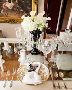 On the dining table, Royal Crown Derby's Gold Aves plates