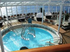 Enjoy some R&R in the Solarium aboard Allure of the Seas.