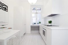 Kitchen-chi out how hood is disguised under faux cabinetry to achieve clean lines