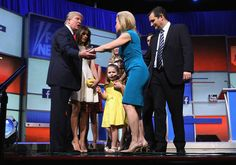 Republican presidential candidate Donald Trump (L) and his wife Melania Trump (2nd L) greet Sen. Ted Cruz (R-TX) (R) and his wife Heidi Nelson Cruz (C) and their children