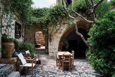 Jasmine engulfs the 16th-century courtyard. Jasper Conran's retreat on the island of Rhodes