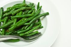Outback Steakhouse Steamed Green Beans . . . excellent with a Honey Baked Ham.  The combo of garlic powder & brown sugar gives it a kick!  Get the fresh french beans from Costco.  Steam 1 of the 2 bags for 10-15 min. Meanwhile in saucepan, melt 4 Tbsp butter. Add 2 Tbsp brown sugar, 1/2 tsp garlic powder, 1/2 tsp soy sauce (Maggi seasoning even better), 1/4 tsp salt, & 1/4 tsp freshly ground pepper.  Add the sauce to beans & toss or stir. Voila!