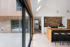 Elliott Architects has completed a family home in Northumberland made up of two volumes clad in opposing materials to represent its forest setting