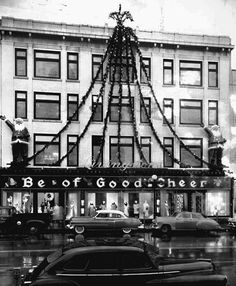 """Livingston's department store in Bloomington, Indiana, urged shoppers to """"Be of Good Cheer"""" in 1955. Image via pantagraph.com."""