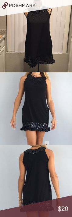 Express Sequin Dress with Ruffle Hem This cute dress was only worn once and is in perfect condition! It has pockets, all sequins are in tact and a ruffle hemline. Express Dresses