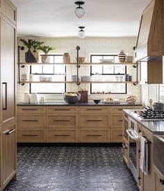 """585 Likes, 7 Comments - Amber Lewis (@amberinteriors) on Instagram: """"Here is a trendy trend I am loving at the moment. Shelving in kitchens over windows!! It's a great…"""""""