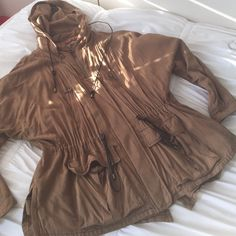 Zara Anorak Jacket Lots of fun details and zippers on this cute jacket! Perfect for springtime wear. Leans towards a green tan (but not green.) Good condition! No visible wear. Zara Jackets & Coats Utility Jackets
