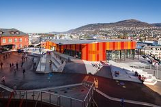 Ny-Krohnborg, Bergen – Centre for Education and Culture. The existing building has been renovated, and the old brick walls, stone foundations and slate roofs are reflected in the colours of the modern materials of the new extension.