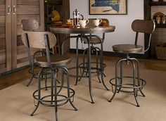 Be the envy of your friends with the Travis 5-piece adjustable-height dining set. This group has an industrial flair with metal frames and rivets bordering the table and stools. The metal is paired with distressed ash hardwood that's attractively presented in a walnut finish. Our favorite thing about this set is how it can go from counter height to bar height with a twist of the table and stools, providing the perfect setting for any get-together.