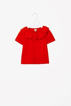 Top with neckline frill
