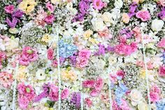 Use flowers - 16 Unique and Beautiful Wedding Backdrop Ideas - EverAfterGuide