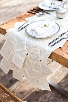 Tablecloth from old books: Good idea? Could recycle afterwards; would get really dirty. I like the tableware but china would be really expensive.