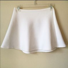 American Apparel High-Waist Mini Skirt White skater skirt. 97% polyester. Has a zipper you can wear in front or back. Never been worn! American Apparel Skirts Mini