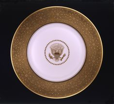 Mamie Eisenhower ordered service plates from Castleton China for use with the Truman state china service.