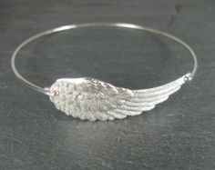 Silver angel wing bangle bracelet Angel Wing by BaubleVine Angel Wings Jewelry, Angel Wing Bracelet, Wedding Jewellery Inspiration, Wedding Jewelry, Bangle Bracelets, Bangles, Enchanted Jewelry, Magical Jewelry, Jewelery