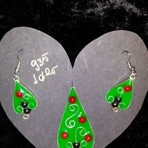 Christmas tree pendant and earrings made from .935 silver wire and band with coral beads encased in epoxy resin.