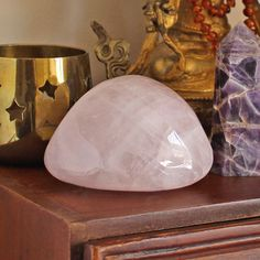 Rose Quartz is the Earth Mother. Comforting to hold and wear. This crystal is ideal for healing self love issues. Opens the Heart Chakra.