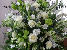 White Wedding Flowers | The church pedestal arrangements were large domes of Avalanche roses ...