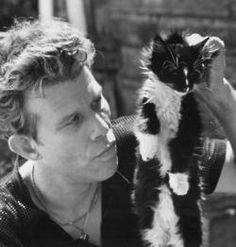 tom waits, outstanding singer songwriter with a distinctive gravelly voice with bittersweet delivery and cat lover.