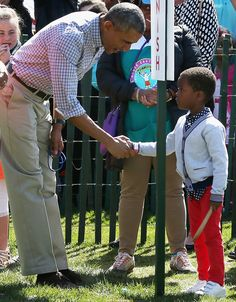 President Obama congratulates a participant during the White House Easter Egg Roll, 4/6/15.