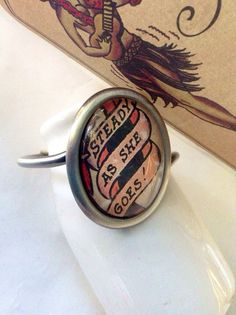 Sailor Jerry Steady as She Goes Nautical Bracelet Upcycled Label in Brushed Silver Steel on Etsy, $22.00 #sailorjerry #sailorjerryjewelry #yesanastasiajewelry
