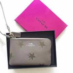 """new   Coach Star Canyon Wristlet  + Gift Box Adorable wristlet from Coach features metallic shooting star design on front and back. Body color is a beautiful brownish-gray. Zip top and two internal credit card compartments. Perfect size for your phone & a few essentials, like lipstick. Comes in gift box.    *style coach f64645   Star Canyon Wristlet  *new with tags, comes in coach pink & black gift box  *measures 6.25"""" x 4.25""""; 6"""" strap drop Coach Bags Clutches & Wristlets"""