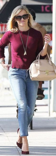 Who made  Reese Witherspoon�s tan handbag, gold jewelry, blue skinny jeans, and black sunglasses