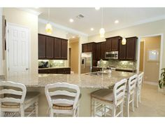 Huge kitchen with large island bar.  Il Regalo in North Naples, Florida
