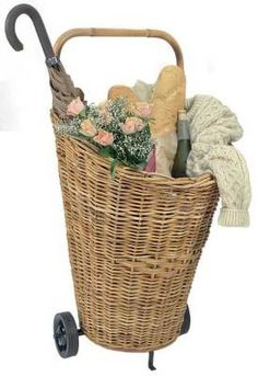 Wicker Cart Shopper chic... this roomy basket-on-wheels will tote anything from groceries to laundry with ease.