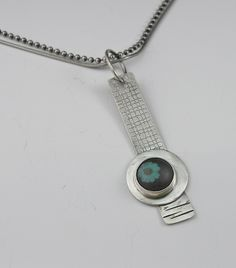 Roll printed sterling silver pendant with one of my mini glass cabochons found in Growing Edge Glass on etsy...sold
