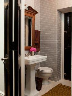 Nate Berkus` Chicago condo bathroom | to the ceiling gray subway, black, white,  & warm woods