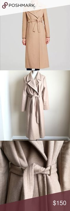 "Calvin Klein Belted Maxi Wool Blend Coat Camel Tan With a sleek, wrap-front silhouette and a long maxi length Calvin Klein's Seventies-inspired winter topper is as flattering as it timeless. 	•	Notch collar, long sleeves, wrap front closure 	•	Detachable self-tie belt, gold-tone metal belt loops, side slit pockets 	•	Back vent, lined  	•	Wool/polyester/acrylic/nylon; lining: polyester  50% wool 25% polyester 22% acrylic 3% nylon  Womens size 16  Measurements taken while laying flat: 18.5""…"