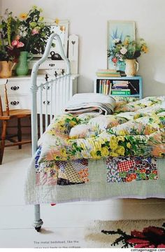 This room is just so appealing to me... unpretentious, yet so inviting...  simple, yet so pretty...gloriously mismatched, but  such a cohesive garden look. It brightens my mood just looking at it! Love.