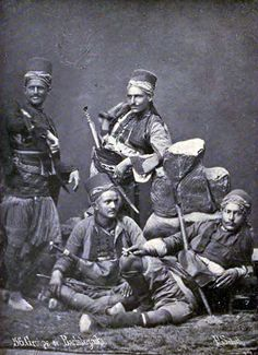"Ottoman mountaineer irregulars, bashi bazouks, in the late 19th century. Date 1896, by Edwin Munsell Bliss, 1848-1919. Bashi-bazouk or bashibazouk (Turkish literally ""damaged head"", meaning ""free headed"", ""leaderless"", ""disorderly"") was an irregular soldier of the Ottoman army. Particularly noted for their lack of discipline."