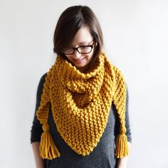 This scarf/shawl knits up quickly in super bulky yarn, and the simple garter stitch design makes for a relaxing and enjoyable knit. A tassel tutorial with photos and instructions is included. You are welcome to sell items knit from this pattern, I just ask that you give pattern credit to Knifty Kn