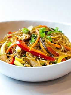 A simple, easy recipe for Japchae, also known as Korean glass noodles with stir fried vegetables. It's made with sweet potato starch noodles, colorful vegetables and tossed in a savory sauce! #japchae #Koreannoodles #glassnoodles #drivemehungry | drivemehungry.com Colorful Vegetables, Fried Vegetables, Japchae Noodles, Korean Red Pepper Flakes, Weeknight Meals, Easy Meals, Korean Glass Noodles, Easy Korean Recipes, Vegetarian Protein